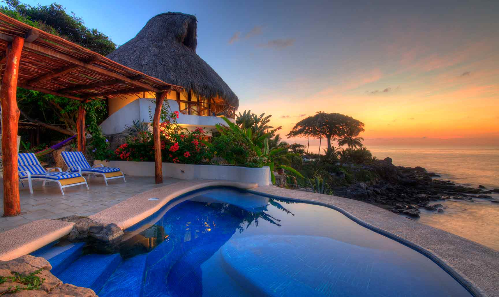 Oceanfront villa with pool by night