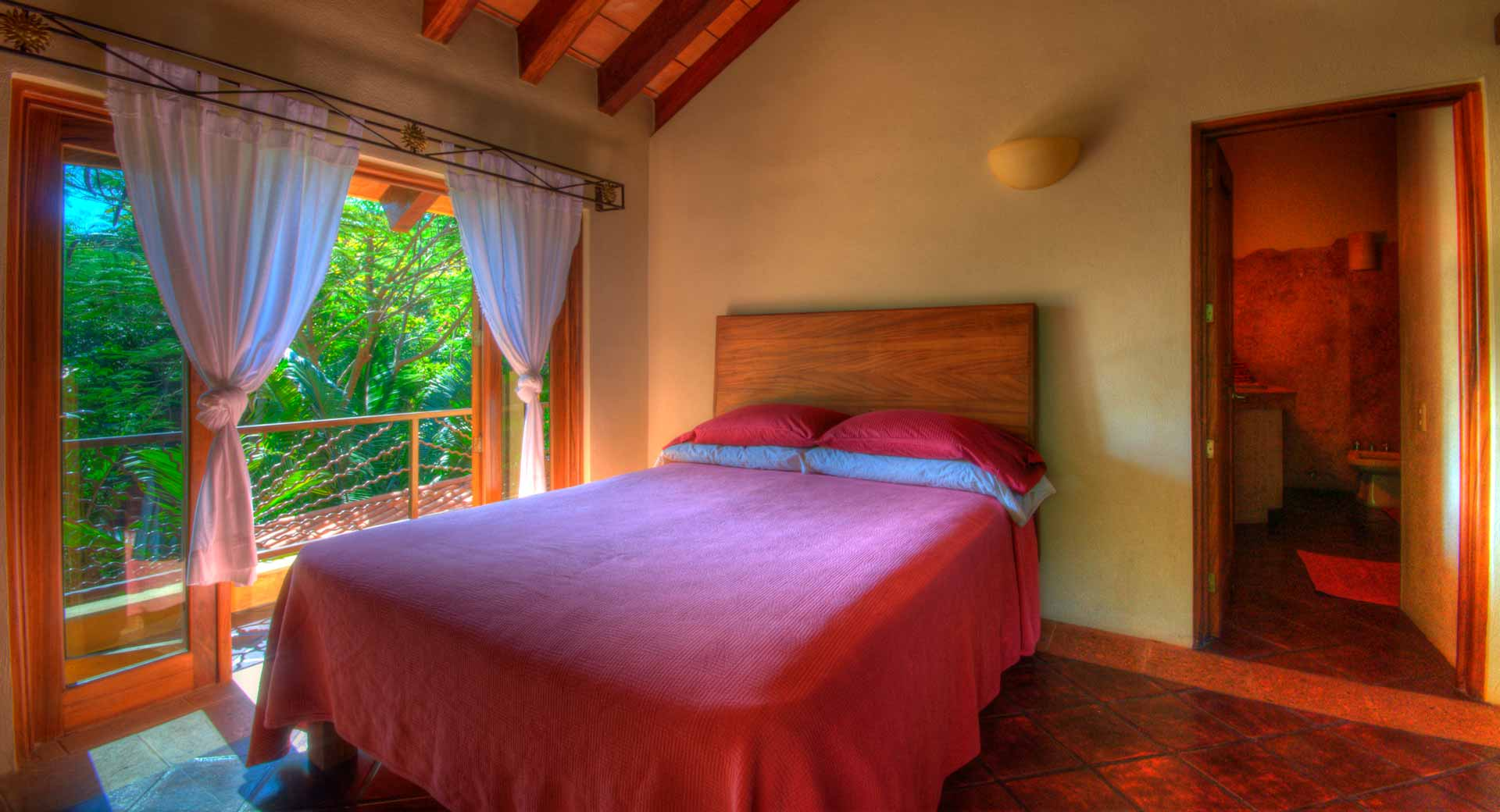 Bedroom with lush vegetation outside